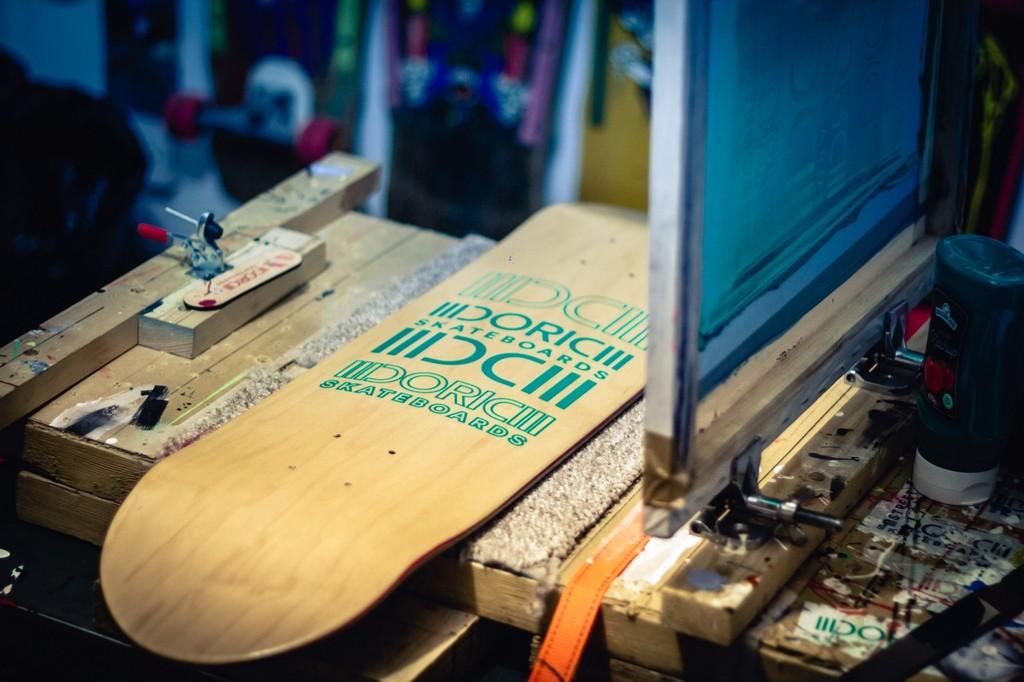 Doric Skateboards on the screen printing rack.  Photo by Chris Sansbury