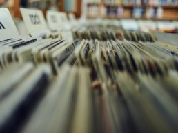 Records stacked in crates